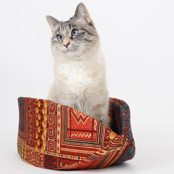 Cat Canoe pet bed made in cayenne red and multi Hoffman fabric with metallic gold details