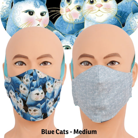Reversible face mask made with pretty blue cat fabric