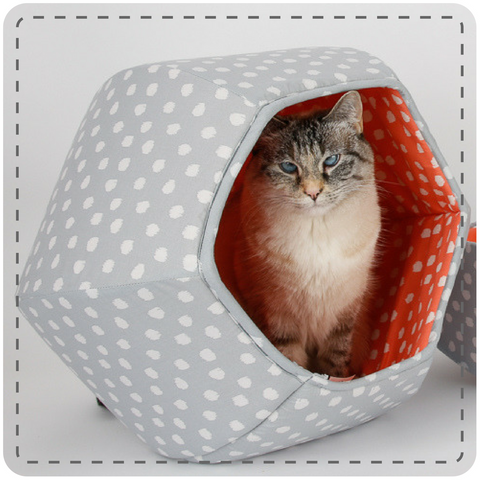 A cat inside the Grey and Coral Polka Dots CAT BALL cat bed