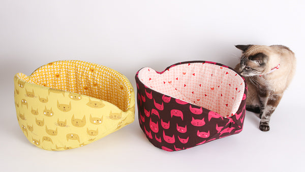 Two custom fabric Cat Canoe® pet beds, made in jumbo size