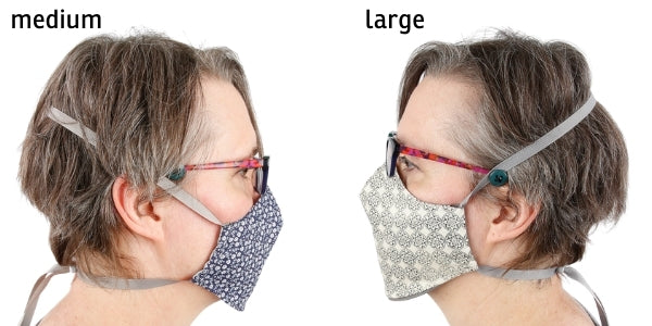 Compare the reversible face mask in size medium to large on the same person