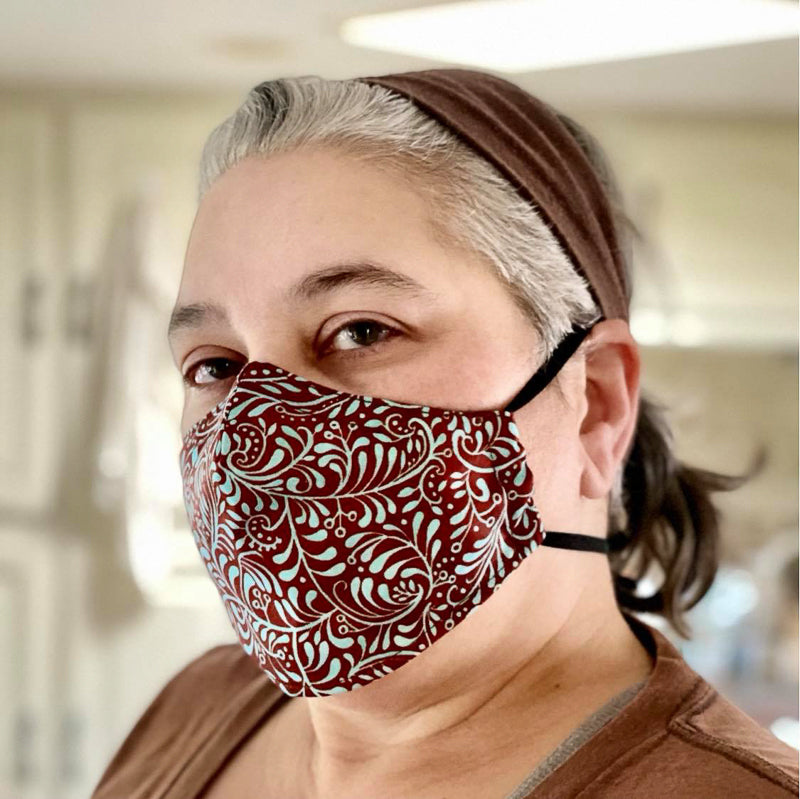 This face mask is shaped to fit the face closely. We used an adjustable elastic headband because we knew the horse trainer who would be wearing it would want a comfortable but secure fit.