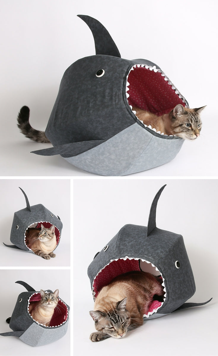 Feed your cat to the apex predator of the living room, the great white shark CAT BALL cat bed! This is a funny cat product design.
