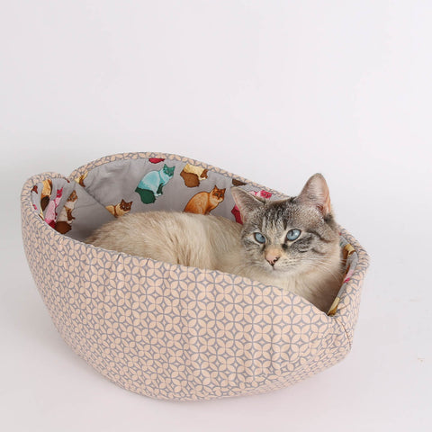 The Cat Canoe pet bed made with cute Rag Doll cat fabric
