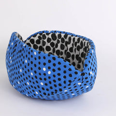 The CAT CANOE modern pet bed in royal blue and black polka dots