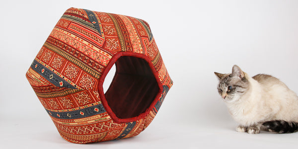 Cat Ball bed made in burgundy and multi color kilim fabric with metallic gold details