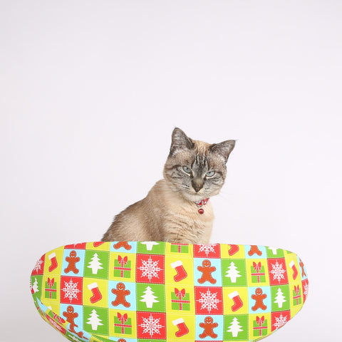 The CAT CANOE cat bed in a Christmas fabric