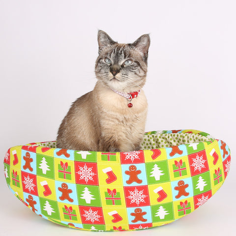 The Christmas Cat Canoe is a modern cat bed made in calico fabric.
