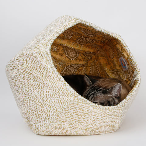 The Cat Ball® cat bed is is made with cotton fabrics over inner foam panels. We use a special technique to keep the lining fabric from collapsing under gravity so your cat can sleep inside the bed no matter what panel it sits on. The bed is entirely flexible and can be folded and smashed.