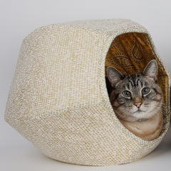 The Cat Ball® cat bed is a hexagonal cat bed with an opening on each end. Made in USA. The cat in this photo weighs 17 pounds.