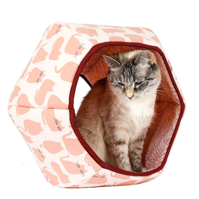 The Cat Ball® is a modern cat bed, made with six foam panels and covered with fabrics, this innovative pet bed design has two openings. This version is made with a cute pink cat fabric.