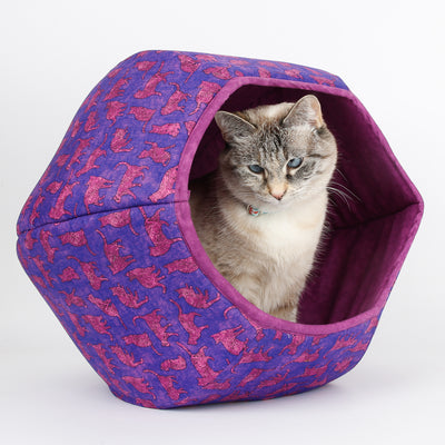 Cat Ball cat bed made in a purple cat print cotton fabric and lined with a purple quilting blender