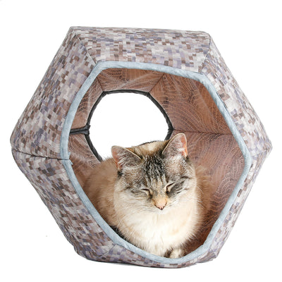 The Cat Ball® cat bed made with a neutral grey fabric that looks like blocks or squares. Our innovative cat bed design is hexagonal and has two openings. Made in the USA.