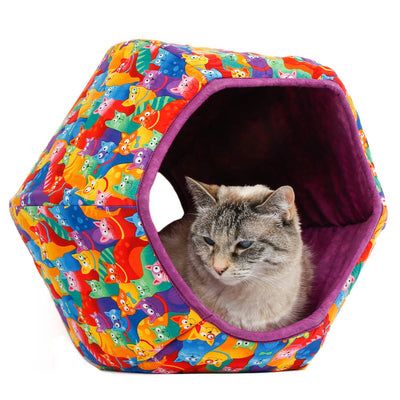 This Cat Ball® cat bed is made with a a cheerful print of rainbow colored kitties and lined with a purple cotton fabric.