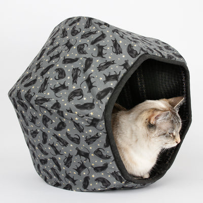Cat Ball cat bed made in a Black cats fabric with a harlequin print lining
