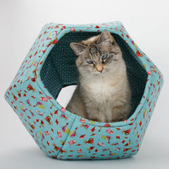 The Cat Ball® cat bed is a comfortable place to sleep. Our original modern cat bed design is made with six foam panels so it is soft and flexible, and it has two openings, one larger than the other. This aqua blue fabric has cute birds and is lined with a coordinating tile print fabric. We make our original, innovative, pet beds designs in the USA in the state of Washington.