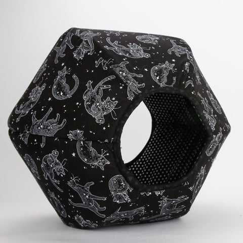 Small opening view of the Cat Ball cat bed made in a in black and white fabric that looks like cat constellations