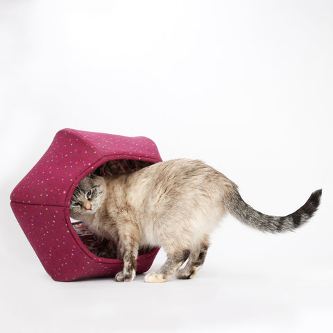 The Cat Ball® cat bed in a dark raspberry cotton with a fun lining of cats with a folkloric look