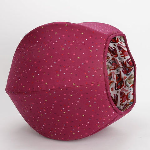 The Cat Ball® cat bed in a dark raspberry cotton with a fun surprise lining of cats with a folkloric look.