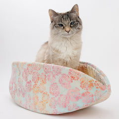 Cat Canoe® is a modern cat bed for cats who like shoeboxes. Made with floral pastel cotton batik fabric