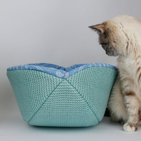 This view shows the Blue Sweater Knit fabric Cat Canoe® turned inside out, showing the lining fabric.