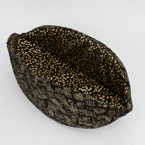 The Cat Canoe® modern cat bed, made in black cottons with shiny gold metallic ink. This cat bed is popular with cats who like to sleep in tight, cozy places.