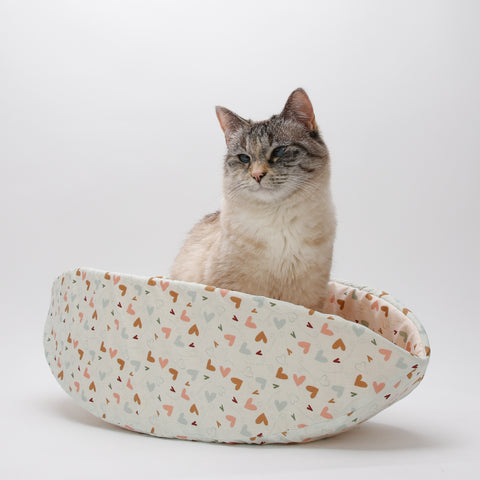 Cat Canoe is a modern cat bed with high sides, creating a private nest for cats and small dogs.