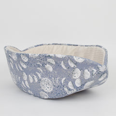 The Cat Canoe® modern cat bed, made a fabric depicting phases of the moon with silver metallic ink details. This cat bed is popular with cats who like to sleep in tight, cozy places.