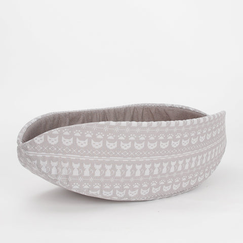Cat Canoe® modern cat bed in a neutral taupe colored cotton fabric with a cute sweater knit print. Made in USA.