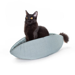Cat Canoe modern cat bed design made with winter in mind, using a teal windowpane plaid and a teal snowflake print for the lining