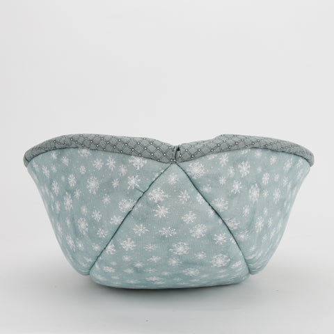 The Cat Canoe modern cat bed design made with winter in mind, using a teal windowpane plaid and a teal snowflake print for the lining.