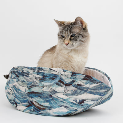 The Cat Canoe® modern cat bed made in a Hoffman fabric depicting blue leaves