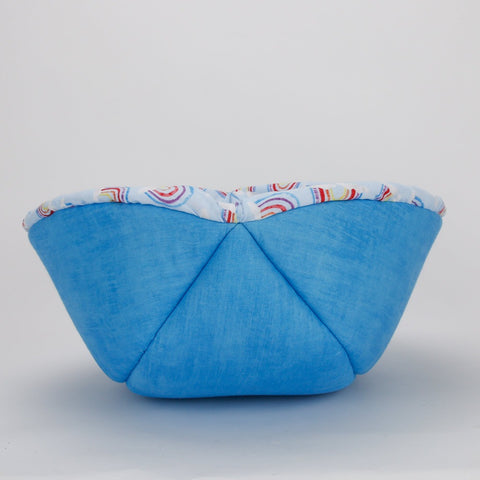 Cat Canoe modern style cat bed made in a pastel blue rainbow print fabric, this is the bed turned inside out