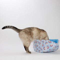 Cat Canoe modern style cat bed made in a pastel blue rainbow print fabric