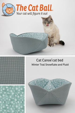 The Cat Canoe is a modern cat bed, made for winter in a teal window pane plaid, lined with teal and white snowflake print.