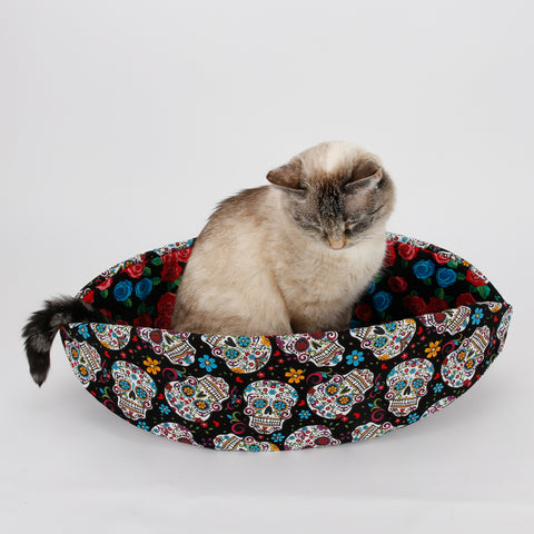 Cat Canoe kitty bed made in bright Mexican sugar skulls fabric for Day of the Dead celebration