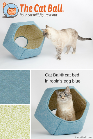 The Cat Ball® cat bed is a hexagonal cat bed with two openings. Our original modern cat bed design is made in a robin's egg blue with a green bird fabric for the lining. This covered, pod style cat bed is made in the USA.