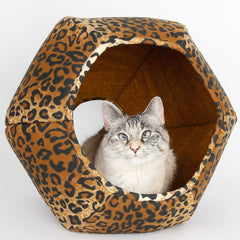 The Cat Ball® cat bed is a cave style cat bed with two openings, so your cat has a door and a window! This hexagonal modern cat bed is our original design, and we make our beds in the state of Washington, USA. This bed is made in a leopard print cotton fabric.