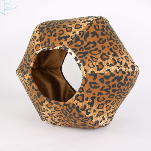 The Cat Ball is a modern cat bed with two openings, made in a cotton leopard fabric