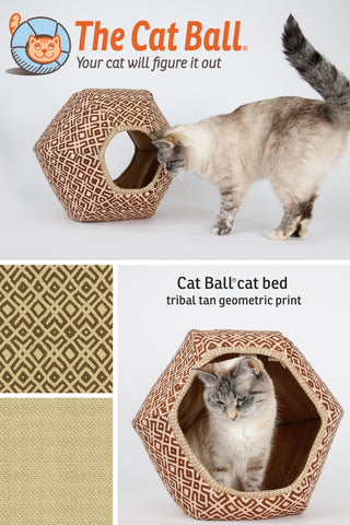 This Cat Ball®cat bed is in a tan and brown fabric with a tribal print. These fabrics have a texture similar to vintage barkcloth, and are 100% cotton. The Cat Ball is a hexagonal cat bed with two openings, perfect for long naps and planning world domination. Made in USA.
