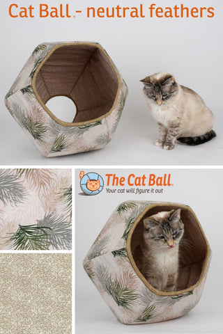 The Cat Ball is a geometric shaped modern cat bed with two openings. This innovative cat bed is made of fabric and foam, is interesting to look at, soft, padded, holds body heat, is washable, and is made in the USA. We've used a print of feathers in neutral shades of grey, tan and green to make this covered cat bed