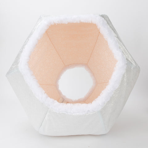 The Snowball Cat Ball® is an all white cat bed. The Cat Ball is a hexagonal cat bed with two openings. Made in USA.