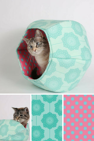 The Cat Ball pet bed made with teal and pink Riley Blake fabrics. Our original hexagonal cave style cat bed is made of fabric and foam and is washable.