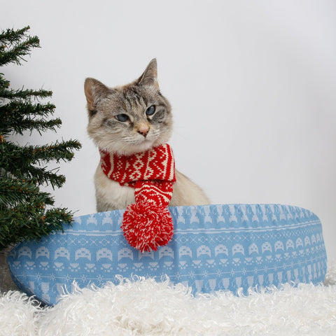 Have an ugly Christmas sweater party in a Cat Canoe! This cute cat bed is made in a cotton fabric printed to look like a sweater. Made in USA.