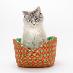 Cat Canoe Christmas cat bed in red and green with golden snowflakes
