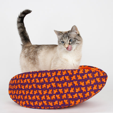 Cat Canoe modern pet bed in purple with cute orange cartoon kitties