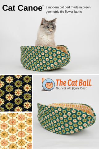 The Cat Canoe is a modern cat bed, made in a green flower tile fabric. These fabrics are 100% cotton. Our pet bed is made in the USA, fits cats and small dogs, and is washable.