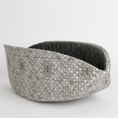The Cat Canoe cat bed made with fabrics that look like steel diamond plate and black denim