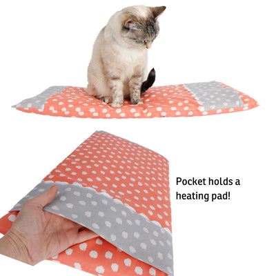 We designed the CATTRESS™ pet bed with a pocket to hold a heating pad, our large size is shown here. The bed is filled with thick batting and can be used with or without a heating pad.