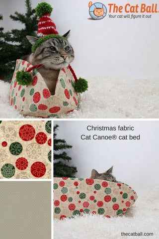 The Cat Canoe is a modern cat bed, made in a snowflake pattern in neutral colors for Christmas. Our washable pet bed is made in the USA with cotton fabrics.